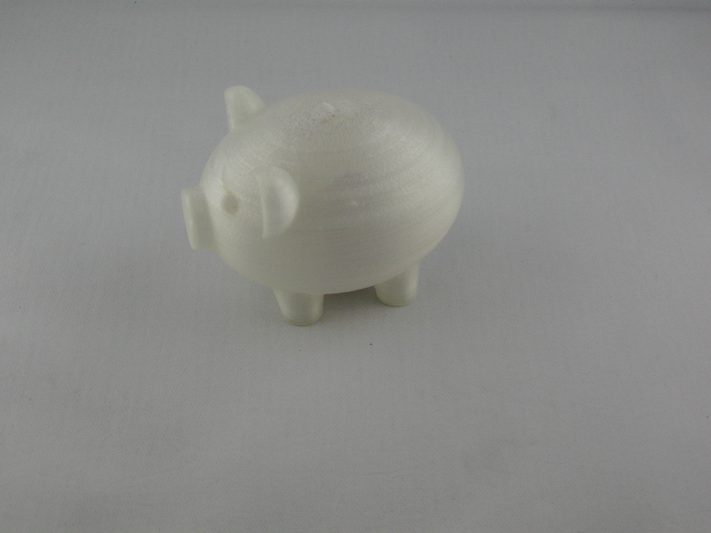 Der fertige Druck: Schwein ohne Schlitz mit Geld im Bauch!